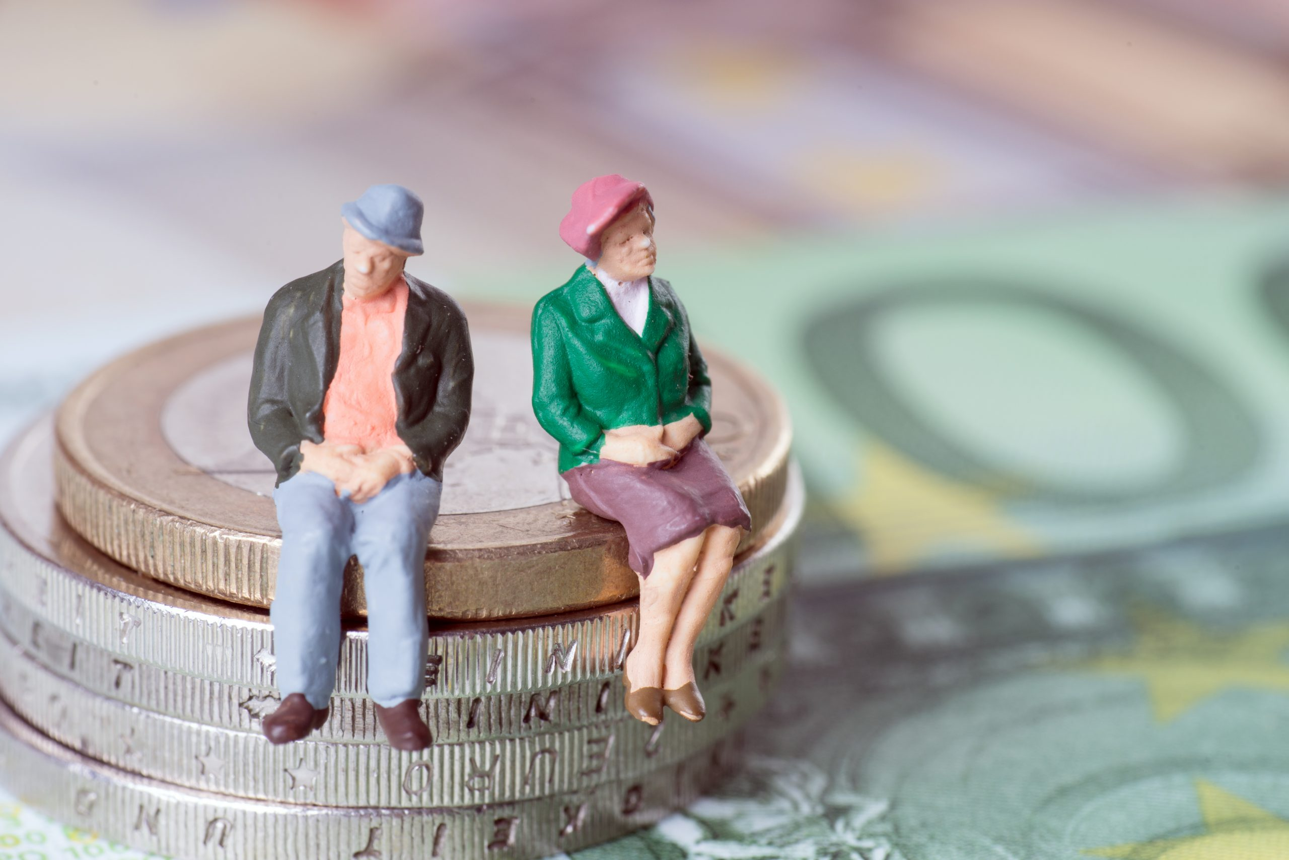 Two people sitting on some coins